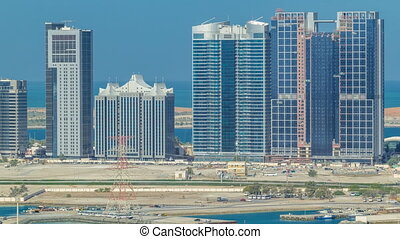 Buildings on Al Reem island in Abu Dhabi timelapse from...