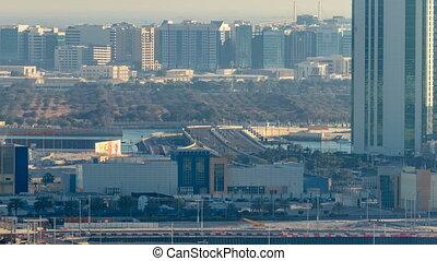 Buildings on Al Reem island in Abu Dhabi timelapse from...