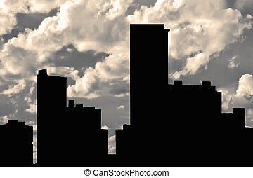 Buildings Silhouette and Cloudy Sky Background