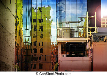 Buildings - Cityscape abstract featuring reflecting...