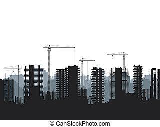 Buildings under construction and building cranes.