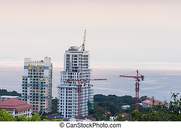 buildings under construction and cranes