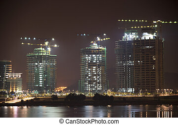 Buildings Under Construction at Night - Night image of...