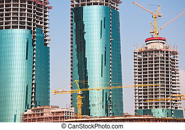 Modern buildings being built on reclaimed land in the Gulf State of Bahrain, Middle East.