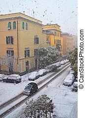 buildings under snowfall in winter
