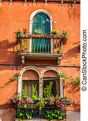 Buildings with traditional Venetian windows in Venice, Italy