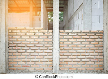 builds a brick wall in the house