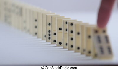 built figure of dominoes falling in slow motion