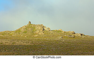Built from stone Cairn at sunset, at midnight, the polar day