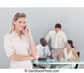 Buiness woman taking on the phone