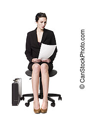 Buisness woman sitting on a chair
