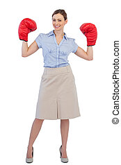 Buisnesswoman posing with boxing gloves