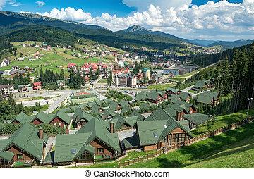 Bukovel, Ukraine - August 21, 2018: Wooden houses in the ski resort.