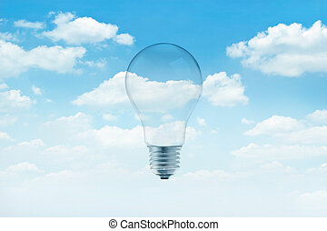 Bulb light on blue sky with white clouds background