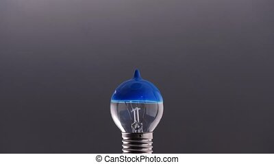 Bulb with blue paint on it - Incandescent bulb with blue...