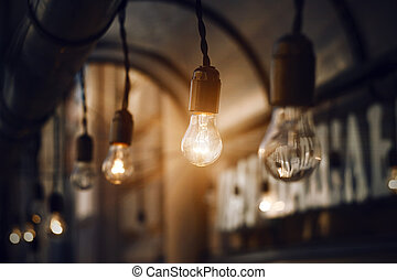Bulbs glow brightly in the darkness of the night