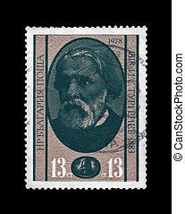 BULGARIA - CIRCA 1978: cancelled stamp printed in Bulgaria, shows famous russian writer Ivan Turgenev (1818-1883), circa 1978. vintage post stamp isolated on black background.