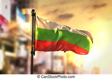 Bulgaria Flag Against City Blurred Background At Sunrise Backlight