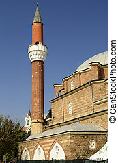 Sofia, Bulgaria - minaret of Banya Bashi mosque, behind the clock tower of Central Sofia Market Hall