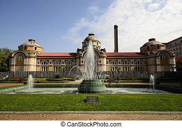 Sofia, Bulgaria - September 28th 2013: Unidentified people in the park with fountain in front of the Sofia Public Mineral Bath