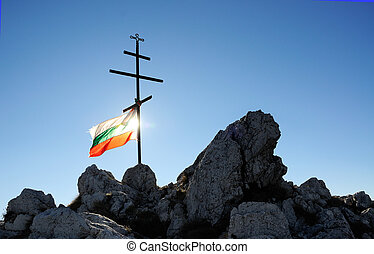 Bulgarian national flag tied on a cross on mountain