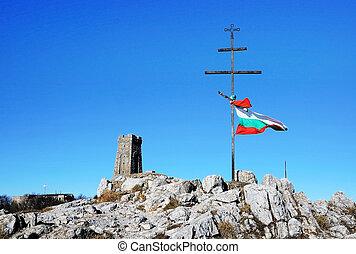 Memorial Shipka view in Bulgaria. Bulgarian flag in front.