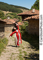 Bulgarian folklore in national costume in the traditional village of Jeravna