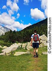 man hiking in high Pirin mountain in Bulgaria