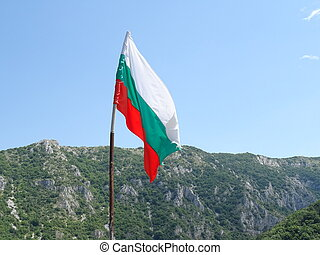 Bulgarian National Flag against the Background of a Mountain
