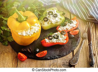 Bulgarian pepper stuffed with cheese with greens and olives.