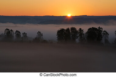 Bulgarian sunrise with fog