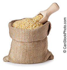 Bulgur in bag with wooden scoop isolated on white background