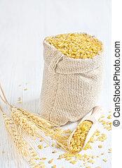 Raw cracked durum wheat or bulgur in bag. Popular ingredient in Middle Eastern cuisine.