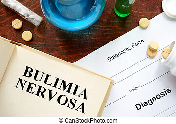 bulimia nervosa written on book with tablets. Medicine...