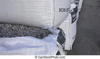 Bulk bags of stone chippings - Close up of an open bulk bag...