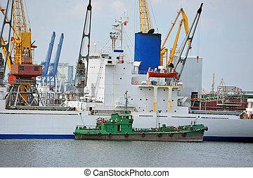 Bulk cargo and bunker ship under port crane
