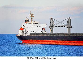 Bulk cargo ship in Odessa harbor quayside