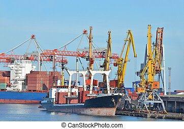 Bulk cargo ship under port crane bridge, Odessa, Ukraine