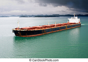Bulk transport carrier under stormy sky - A bulk freighter...