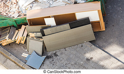 Bulky waste, messy trash in container