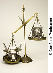 Bull and Bear heads opposite on balance scales.
