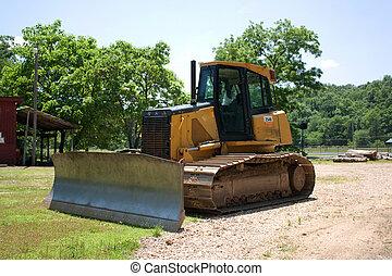 Bull dozer - A bull dozer parked at a job site.