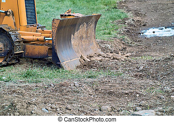 Bull Dozer - Front of a bull dozer at a construction site