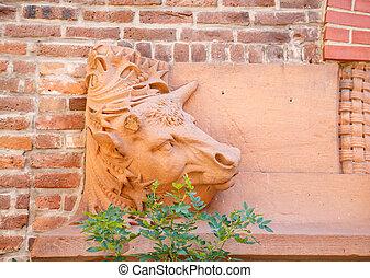 Bull Sculpture on Brick Wall
