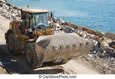 Bulldozer - A bulldozer working in Gibraltar carrying gravel...