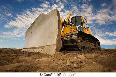 Bulldozer - A large yellow bulldozer at a construction site...