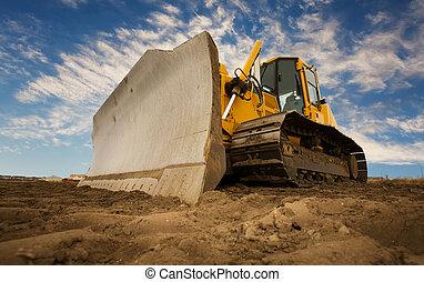 Bulldozer - A large yellow bulldozer at a construction site ...