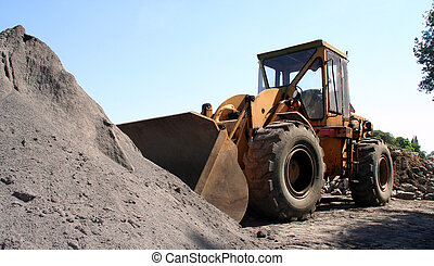 Bulldozer - bulldozer in front of a pile of sand