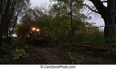 bulldozer buries bat on a bright