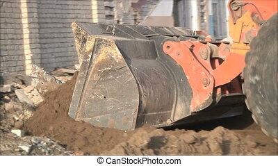 bulldozer clears debris